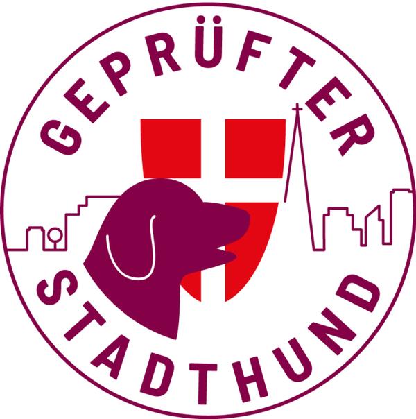 Vignette Geprüfter Stadthund mit Hund im Profil vor Stadtkulisse und Wien-Wappen